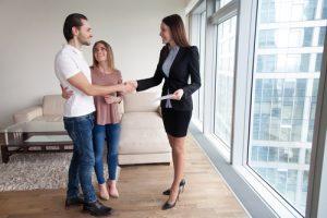 Happy beautiful couple friendly realtor handshaking making rental agreement property investment rebate landlord in Ontario