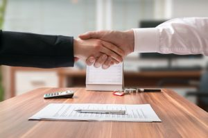 shaking hands doing business contract office real estate vaughan
