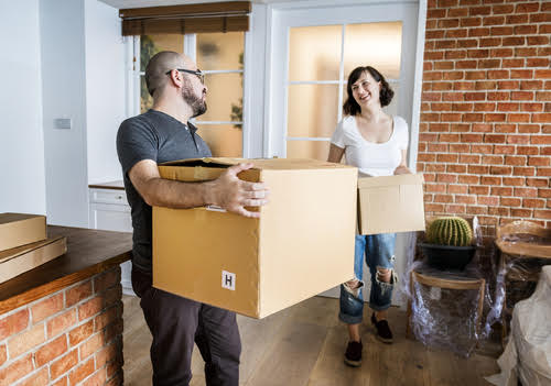 couple, man, woman, boxes, home, condo, rental rebate, hst